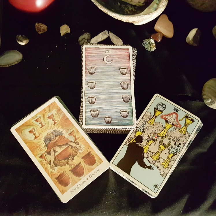 The 9 of Vessels / Cups from The Wild Wood tarot, Wild Unknown Tarot, and Smith Tarot.