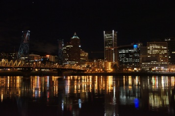 City of Portland - Skyline by night with lights reflecting in the river.